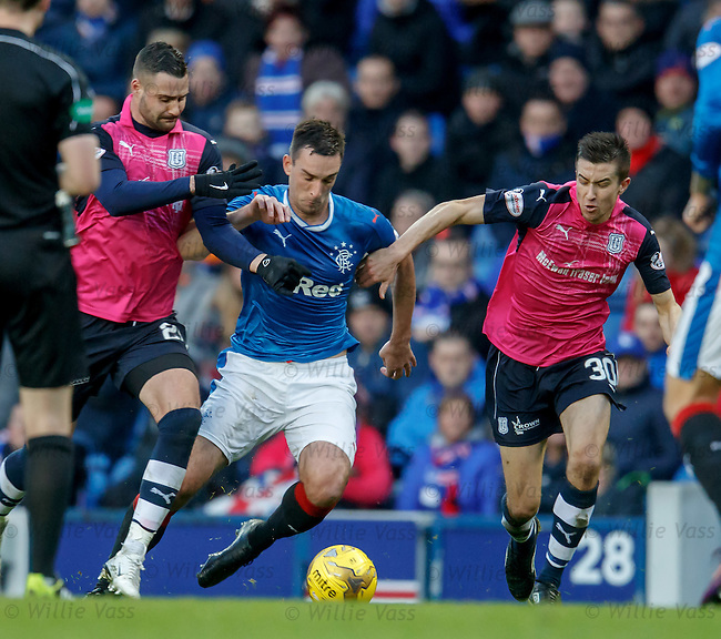 Lee Wallace burts past Marcus Haber and Cammy Kerr