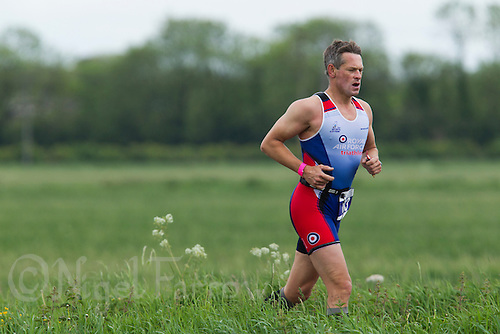 25 MAY 2014 - BRIGG, GBR - Will Thurrell (GBR) of Great Britain runs through the Lincolnshire countryside during the World Quadrathlon Federation 2014 Middle Distance World Championships at the Brigg Bomber in Brigg in Lincolnshire, Great Britain (PHOTO COPYRIGHT © 2014 NIGEL FARROW, ALL RIGHTS RESERVED)