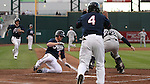 Reno Aces pitcher Barry Enright slides safely into home against Tuscon Padres catcher Kyle Phillips during Thursday's Aces game, June 16, 2011, in Reno, Nev. Aces Evan Frey (14) also scored on the three-run double by Tony Abreu in the third inning. .Photo by Cathleen Allison
