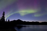 Aurora borealis reflecting in the Koyukuk River, Brooks Range, Arctic, Alaska.