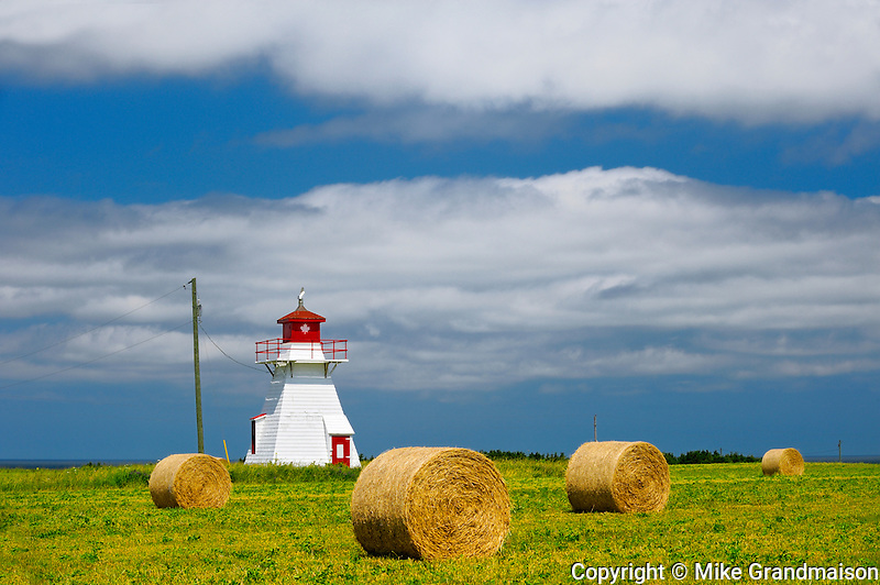 Lighthouse and bales<br /> Darnley<br /> Prince Edward Island <br /> Canada