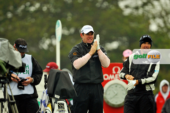 Lee Westwood tries to stay warm as he waits to start his second 9 holes the 1st tee during Round 2 of the 3 Irish Open on 15th May 2009 (Photo by Eoin Clarke/GOLFFILE)