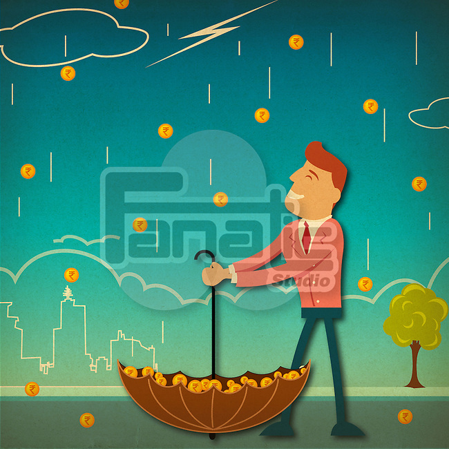 Businessman catching money in an umbrella