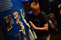 Canton, OH - August 3, 2018: At the Pro Football Hall of Fame Museum in Canton, OH, a boy checks his hand size against NFL players, August 4, 2018. (Photo by Don Baxter/Media Images International)