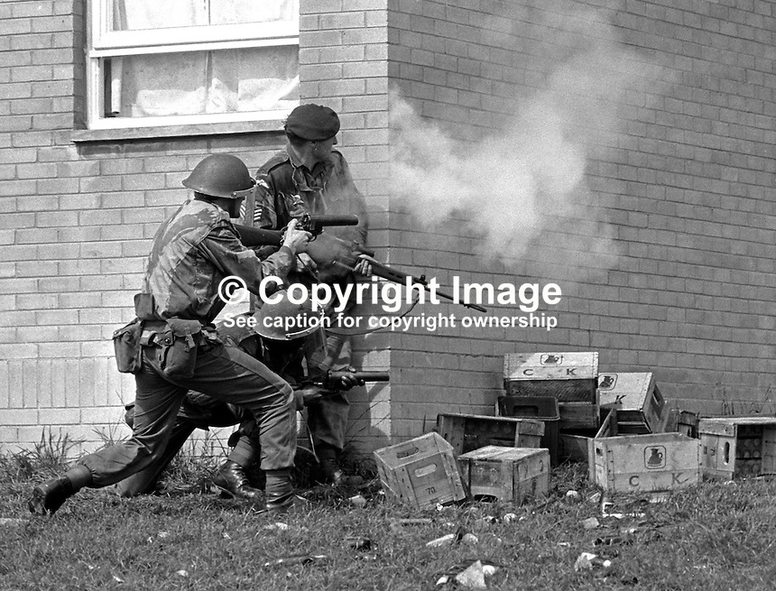 British soldiers fire rubber bullets at rioters in the Lenadoon Avenue area, of Belfast, N Ireland, UK, during widespread disturbances which followed the introduction of internment without trial. 197108000387b...Copyright Image from Victor Patterson, 54 Dorchester Park, Belfast, UK, BT9 6RJ..Tel: +44 28 9066 1296.Mob: +44 7802 353836.Voicemail +44 20 8816 7153.Skype: victorpattersonbelfast.Email: victorpatterson@mac.com.Email: victorpatterson@ireland.com (back-up)..IMPORTANT: If you wish to use this image or any other of my images please go to www.victorpatterson.com and click on the Terms & Conditions. Then contact me by email or phone with the reference number(s) of the image(s) concerned.
