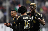 Calcio, Serie A: Frosinone vs Juventus. Frosinone, stadio Comunale, 7 febbraio 2016.<br /> Juventus&rsquo; Juan Cuadrado, center, celebrates with teammate Paul Pogba, right, after scoring during the Italian Serie A football match between Frosinone and Juventus at Frosinone's Comunale stadium, 7 January 2016.<br /> UPDATE IMAGES PRESS/Isabella Bonotto