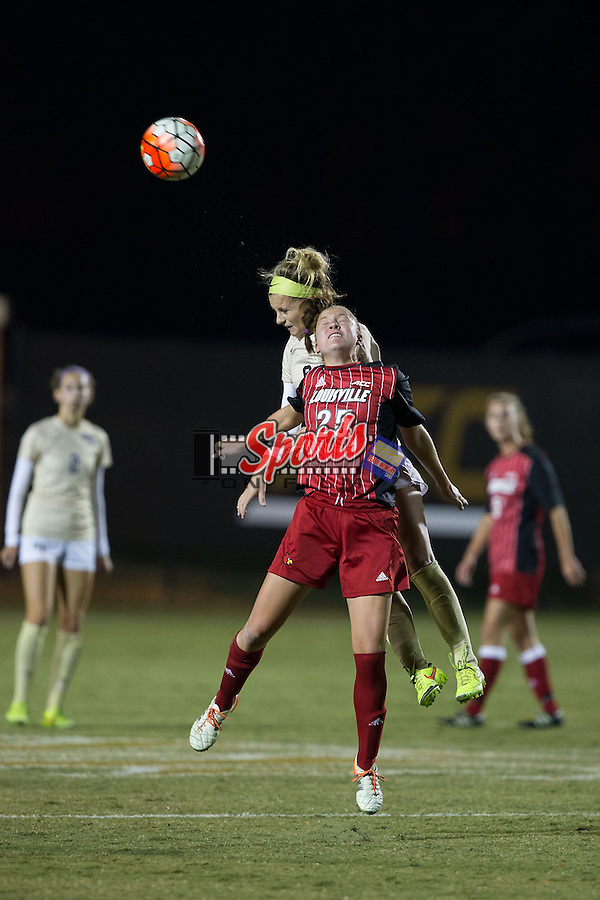 Caroline Kimble (25) of the Louisville Cardinals battles for a jump ball with Bayley Feist (9) of the Wake Forest Demon Deacons during first half action at Spry Soccer Stadium on October 31, 2015 in Winston-Salem, North Carolina.  The Demon Deacons defeated the Cardinals 2-1.  (Brian Westerholt/Sports On Film)