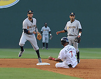 Infielder Cito Culver (2) of the Charleston RiverDogs turns a double play, putting out Jose Garcia (7) of the Greenville Drive in a game on June 3, 2012, at Fluor Field at the West End in Greenville, South Carolina. Charleston won, 5-3. Culver is the Yankees' No. 12 prospect, according to Baseball America and was a first-round draft pick in 2010. (Tom Priddy/Four Seam Images)