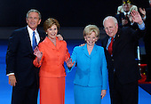 New York, NY - September 2, 2004 --  United States President George W. Bush, left, first lady Laura Bush, left center, Lynne Cheney, right center, and United States Vice President Dick Cheney, right, wave to convention delegates from the podium following the acceptance speech at the 2004 Republican Convention in Madison Square Garden in New York, New York on Thursday, September 2, 2004.  In his remarks, the President spoke about where he wants to lead the United States for the next four years.  .Credit: Ron Sachs / CNP.(RESTRICTION: No New York Metro or other Newspapers within a 75 mile radius of New York City)