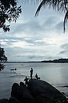 The Marowijne River, Suriname.  Fishing on the river at dusk.