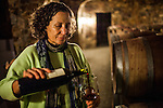 BAJA CALIFORNIA - NOVEMBER 25, 2013:  Natalia Badan, owner of the Mogor Badan winery, pours wine in her Valle de Guadalupe wine cave. Badan, a lifelong resident of the valley, and others in Mexico's wine country are protesting the mayor's relaxing of zoning regulations they say will lead to a drastic change in the culture of  the popular tourist destination.  CREDIT: Max Whittaker for The New York Times