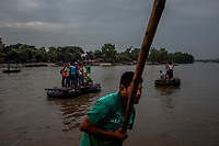MEXICO - OCTOBER 16: Guatemalan migrants cross the river Suchiate that intersects the Hidalgo/Tecun Uman Mexican border crossing with Guatemala on the 16th of October, 2015 in Ciudad Hidalgo, Mexico. <br /> Daniel Berehulak for The New York Times