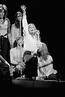 "27 Oct 1972 --- Melina Mercouri giving support during a Women-Only concert to Senator George McGovern of South Dakota, the Democratic candidate for the presidential campaign against Richard Nixon. The ""Musical Spectacular"" at Madison Square Garden also showcased the talents of Dionne Warwick, Tina Turner, Mary Travers, Shirley McLaine, Judy Collins, Bette Davis, with the support of Rose Kennedy. --- Image by © JP Laffont"