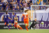 Orlando, Florida - Saturday, April 23, 2016: Orlando Pride goalkeeper Ashlyn Harris (1) makes a diving save on a breakaway by Houston Dash forward Janine Beckie (11) during an NWSL match between Orlando Pride and Houston Dash at the Orlando Citrus Bowl.