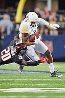 Texas Tech linebacker Aiavion Edwards (20) brings down Baylor wide receiver Antwan Goodley (5) during an NCAA Football game, Saturday, November 29, 2014 in Arlington, Tex. Baylor defeated Texas Tech 48-46. (Mo Khursheed/TFV Media via AP Images)