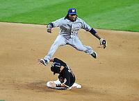 May 8, 2010; Phoenix, AZ, USA; Milwaukee Brewers second baseman Rickie Weeks leaps over Arizona Diamondbacks base runner Augie Ojeda after forcing him out at second to start a double play in the fifth inning at Chase Field. Mandatory Credit: Mark J. Rebilas-