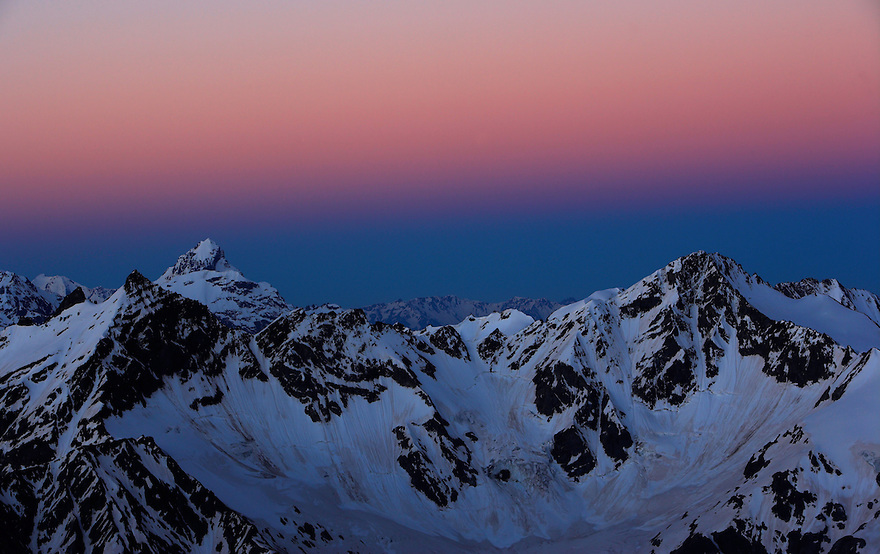 Russia, Caucasus, mountain range before sunrise, red sky, seen from Elbrus.