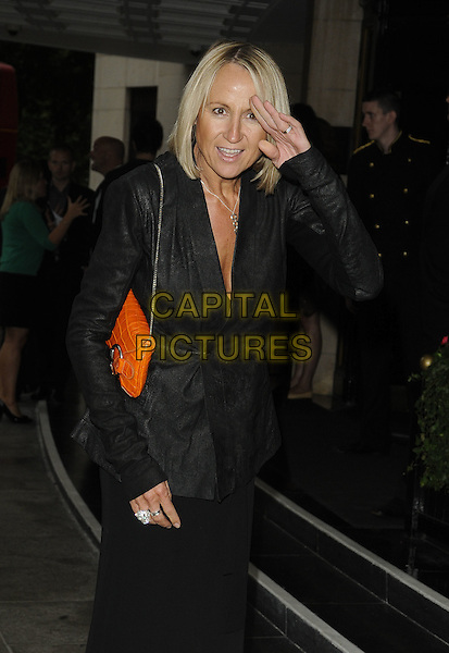 CAROL McGIFFIN.TV Choice & TV Quick Awards at the Dorchester Hotel, Park Lane, London, England. .September 7th 2009.half length black blazer suit jacket red bag purse hand orange.CAP/CAN.©Can Nguyen/Capital Pictures.