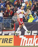 New York Red Bulls defender Heath Pearce (3) heads the ball. In a Major League Soccer (MLS) match, the New England Revolution (blue) tied New York Red Bulls (white), 1-1, at Gillette Stadium on May 11, 2013.