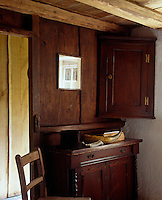 A 17th-century court cupboard, a forerunner of the Welsh dresser, and a wall mounted corner cupboard