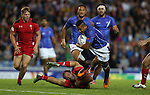 Glasgow 2014 Commonwealth Games<br /> Alatasi Tupou gets away from Will Harries.<br /> Wales v Samoa<br /> Ibrox Stadium<br /> <br /> 26.07.14<br /> &copy;Steve Pope-SPORTINGWALES