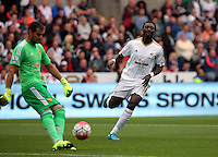 Pictured L-R: Bafetimbi Gomis of Swansea against goalkeeper Sergio Romero (L) of Manchester United Sunday 30 August 2015<br /> Re: Premier League, Swansea v Manchester United at the Liberty Stadium, Swansea, UK
