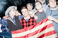 """A group of students from George Washington University join together while Sam Moore sings """"America The Beautiful"""" during the Make America Great Again! Welcome Celebration honoring soon-to-be president Donald Trump at the Lincoln Memorial in  Washington, D.C., on Thurs., Jan. 19, 2017, the day before the presidential inauguration of Donald Trump. The event had musical performances, speeches, and an appearance by Trump and his family."""