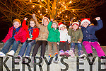 Dylan McCoy, Sorcha Teabo, Sarah Bodenham, Eana Teabo, Emma Bodenham, Hailey Fitzgerald O'Connor, Alison O'Brien enjoying the Ardfert Children Carol Singing at the Tree Lighting in the Village Square on Sunday