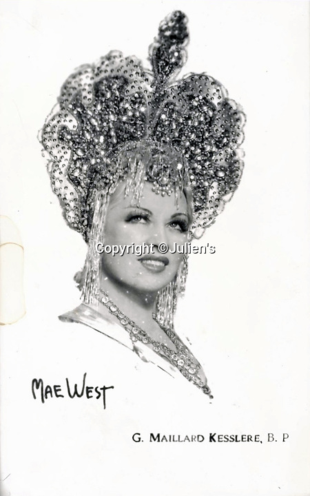 "BNPS.co.uk (01202 558833)<br /> Pic:  Julien's/BNPS<br /> <br /> Larger than life - Mae West wearing the heavily embellished gold lamé headdress, est. £1,600.<br /> <br /> A selection of trailblazing 1930s starlet Mae West's most recognisable film costumes have emerged for sale for £320,000. ($400,000)<br /> <br /> The auction features the actress and screenwriter's gowns, headdresses and tiaras, as well as props from her films and her scripts.<br /> <br /> West, a New York native, was the Marilyn Monroe of her era, earning a 'bad girl' reputation for starring in risque productions.<br /> <br /> She famously coined the phrase: ""When I'm good, I'm very good, but when I'm bad, I'm better."""