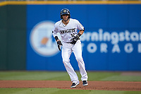 Paulo Orlando (16) of the Charlotte Knights takes his lead off of first base against the Rochester Red Wings at BB&T BallPark on May 14, 2019 in Charlotte, North Carolina. The Knights defeated the Red Wings 13-7. (Brian Westerholt/Four Seam Images)