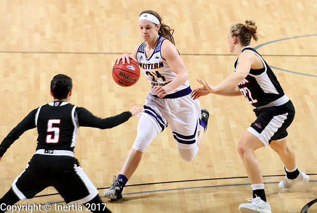 SIOUX FALLS, SD: MARCH 6: Taylor Higginbotham #24 from Western Illinois looks to split the defense of Amber Vidal #5 and Mikaela Shaw #22 from Omaha during the Summit League Basketball Championship on March 6, 2017 at the Denny Sanford Premier Center in Sioux Falls, SD. (Photo by Dave Eggen/Inertia)