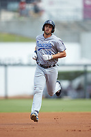Alex Kirilloff (19) of the Pensacola Blue Wahoos rounds the bases after hitting a home run against the Birmingham Barons at Regions Field on July 7, 2019 in Birmingham, Alabama. The Barons defeated the Blue Wahoos 6-5 in 10 innings. (Brian Westerholt/Four Seam Images)