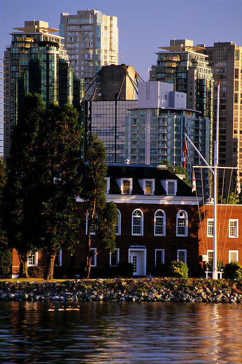 Colonial style buildings with office towers and condominiums in background, and Canada Geese in Coal Harbor, taken from seawall in Stanley Park, Vancouver, BC.