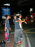 MALAYSIA, Kuala Lumpur, Asia, portrait of skateboarders standing at street and smiling