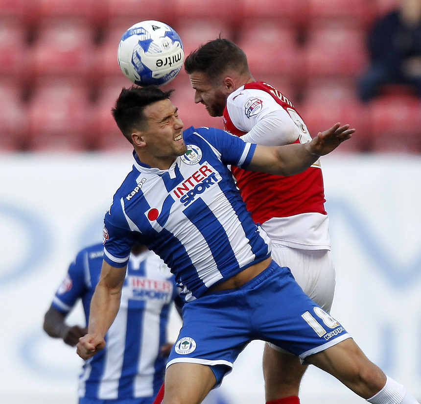 Fleetwood Town's Jimmy Ryan jumps with  Wigan Athletic's Tim Chow<br /> <br /> Photographer Mick Walker/CameraSport<br /> <br /> Football - The Football League Sky Bet League One - Wigan Athletic v Fleetwood Town - Saturday 19th September 2015 - DW Stadium - Wigan<br /> <br /> &copy; CameraSport - 43 Linden Ave. Countesthorpe. Leicester. England. LE8 5PG - Tel: +44 (0) 116 277 4147 - admin@camerasport.com - www.camerasport.com