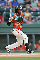 Second baseman Mason Davis (7) of the Greensboro Grasshoppers bats in a game against the Greenville Drive on Tuesday, August 25, 2015, at Fluor Field at the West End in Greenville, South Carolina. Greenville won, 7-0. (Tom Priddy/Four Seam Images)