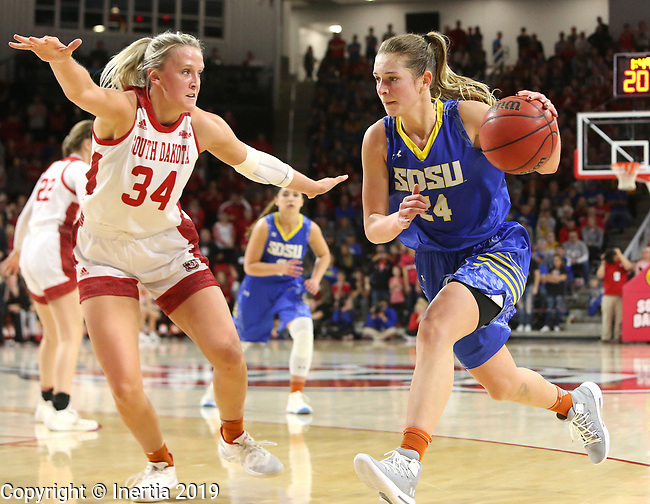 VERMILLION, SD - JANUARY 6: Tagyn Larson #24 from South Dakota State University drives against Hannah Sjerven #34 from the University of South Dakota during their game Sunday afternoon at the Sanford Coyote Center in Vermillion, SD. (Photo by Dave Eggen/Inertia)