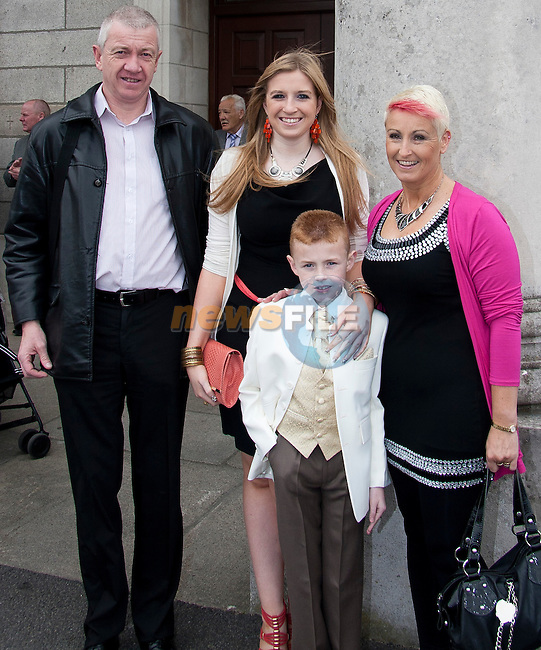 Gavin McCormack makes his communion. Pictured with Paul, Lorna and Fiona McCormack..Picture: Shane Maguire / www.newsfile.ie.