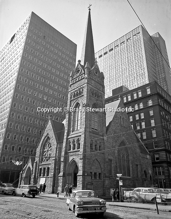 Pittsburgh PA: View of the First English Evangelical Church in downtown Pittsburgh - 1958.  Founded in 1837, the church was the first English-speaking Lutheran Church west of the Allegheny Mountains. This building on Grant Street was dedicated in 1888.   H.K. Porter building in the background