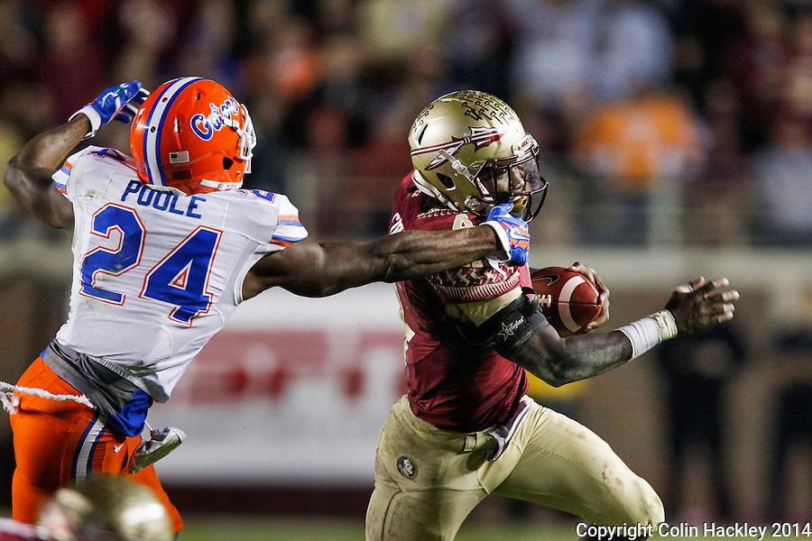 TALLAHASSEE, FL 11/29/14 FSU-UF112914-University of Florida's Brian Poole gets a hand on the shoulder of Florida State's Dalvin Cook  during second half action Saturday at Doak Campbell Stadium in Tallahassee. The Seminoles beat the Gators 24-19.<br /> COLIN HACKLEY PHOTO