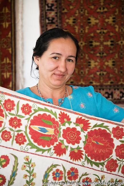 Feruza Khamariva from Uzbekistan displays her fabrics ar the 2009 Santa Fe International Folk Art Market held each July in Santa Fe, New Mexico
