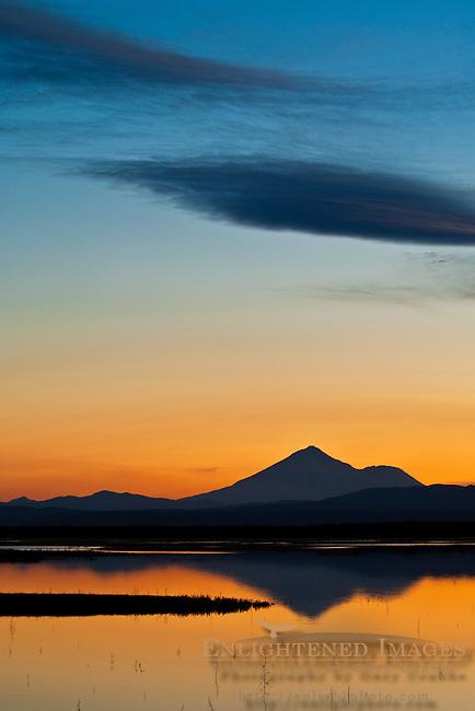 Sunset light and clouds over Mount Shasta reflected in Lower Klamath Lake, Lower Klamath National Wildlife Refuge, California