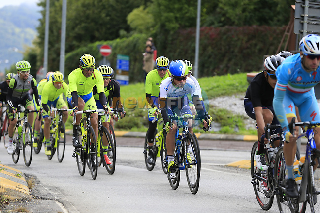 The peloton speed through Calco during the last classic of the season Il Lombardia 2015 running 245km from Bergamo to Como, Italy. 4th October 2015.<br /> Picture: Eoin Clarke | Newsfile