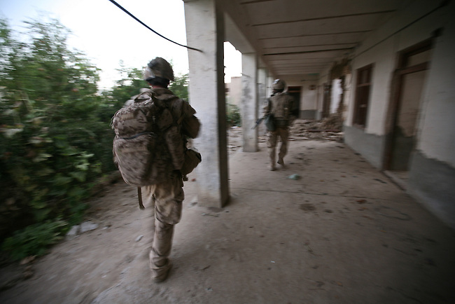 Canadian soldiers with the Royal 22nd Regiment move quickly through a bomb-damaged compound to get closer to three Taliban fighters they have just shot and killed in the village of Zalakhan in Kandahar province, Afghanistan. Aug. 8, 2009. DREW BROWN/STARS AND STRIPES