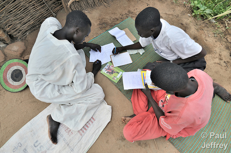 Boys from Darfur studying their school work together in the Goz Amer refugee camp in eastern Chad. More than a quarter million residents of Darfur live in camps in Chad, along with almost 200,000 Chadians who have been internally displaced by related violence.