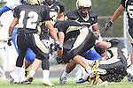 Palos Verdes, CA 09/16/11 - Julius Wilson (Culver City #4), Tommy Webster (Peninsula #49) and \unidentified Peninsula player(s) in action during the Culver City-Peninsula varsity football game.