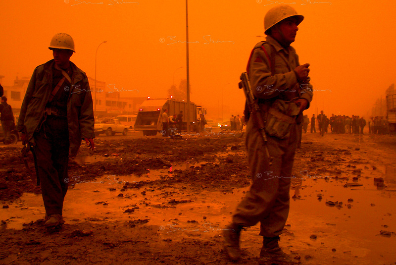 Baghdad, Iraq, March 26, 2003.Civil defense members patrol the site where two US bombs fell without apparent reason in Cha'ab avenue, a busy street on the edge of Saddam City, one of the poorest neighbourhood in Baghdad.