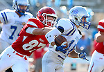 SIOUX FALLS, SD, AUGUST 27:  Trent Naasz #87 from Sioux Falls Lincoln tracks down Jamin Wurtz #10 from Rapid City Stevens in the first half of their game Saturday night at Howard Wood Field. (Photo by Dave Eggen/Inertia)
