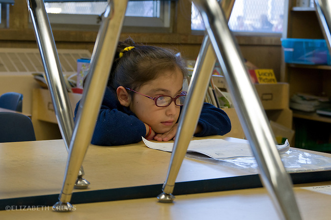 Oakland Ca Latina 2nd grade student waiting for class to start in morning