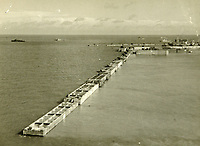 BNPS.co.uk (01202 558833)<br /> Pic: MitchellsAuctionHouse/BNPS<br /> <br /> PICTURED: View of western arm of finished breakwater at Arromanches, Normandy<br /> <br /> The fascinating archive of one of the engineers who designed the Mulberry Harbours which were installed off the Normandy coast following the D-Day landings has come to light.<br /> <br /> Colonel Vassal Charles Steer-Webster OBE helped create the giant, floating artificial harbours which protected anchored supply ships from German attacks.<br /> <br /> They were built in the dry docks on The Thames and Clyde and pulled across the channel by tugs before being hastily assembled.<br /> <br /> Col Steer-Webster was in almost daily contact with Churchill during their development ahead of June 6, 1944. Now, his personal effects, including a letter of thanks from Winston Churchill, are being sold by his nephew with Mitchells Auctioneers, of Cockermouth, Cumbria. <br /> <br /> The archive, which is expected to fetch £15,000, also features 150 photos showing Mulberry B's construction and use, as well as his medals.